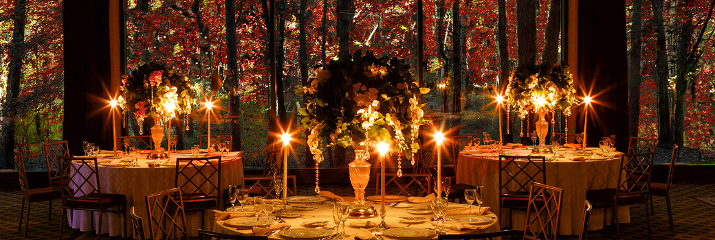 Photo of dining tables with lit candles