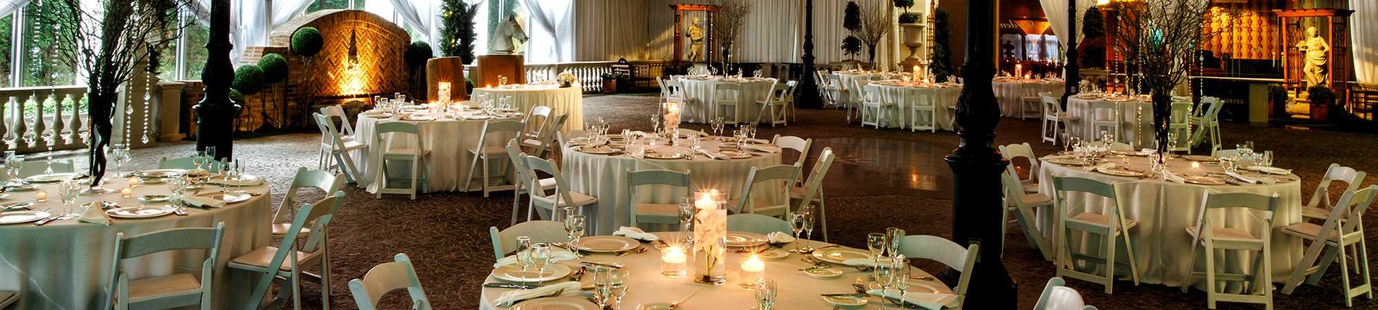 photo of Dining hall with white tables and candles