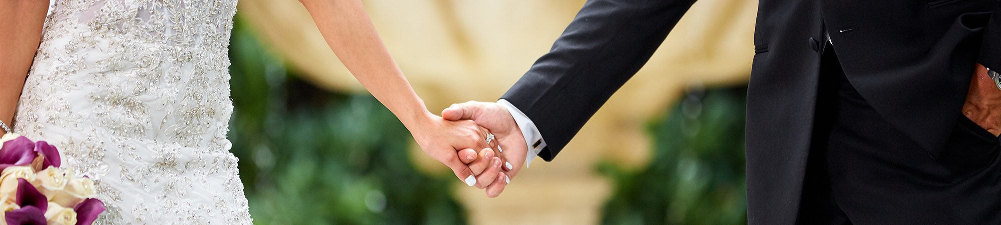 photo of Couple holding hands